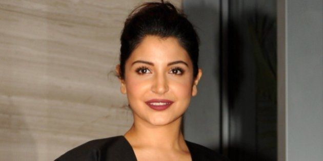 Indian Bollywood actress Anushka Sharma poses for a photograph during a promotional event for the Hindi...