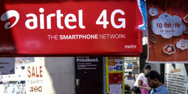 An advertisment for Bharti Airtel Ltd. sits outside a sim card vendor's stall in Mumbai, India, on Monday,...