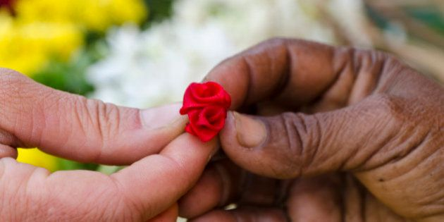 MADURAI, TAMIL NADU, INDIA - 2011/01/07: Little artificial flower given to a tourist for gift as a sign...