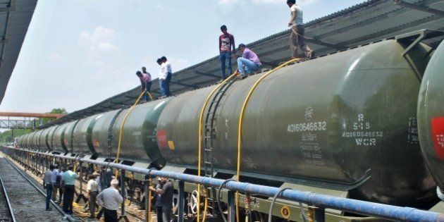 SANGLI, INDIA - APRIL 11: Workers feeling water tankers train carrying water to drought affected areas...