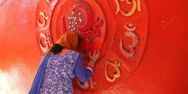 An Indian Hindu woman devotee prays at a temple on the occasion of the Mahashivratri festival in Jammu,...