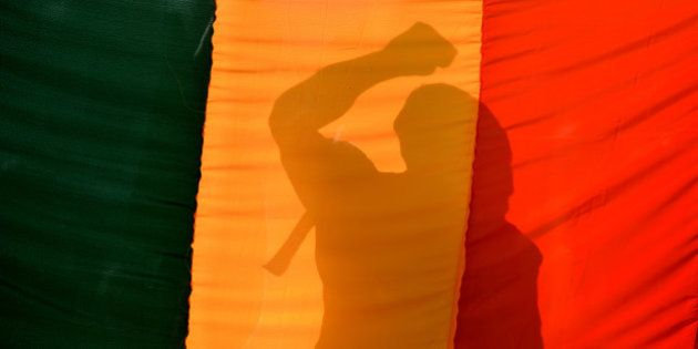 An Indian gay-rights activist gestures behind a flag during a protest against the Supreme Court ruling...
