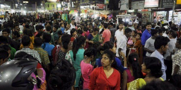 People crowd onto the street during an earthquake in Agartala, capital of India's northeastern state...