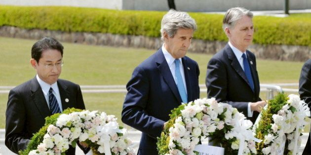U.S. Secretary of State John Kerry (2nd L) prepares to lay a wreath at the cenotaph with Japan's Foreign...