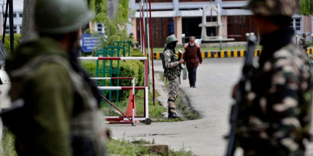 Indian paramilitary soldiers stand guard near the main gate of the National Institute of Technology (NIT),...
