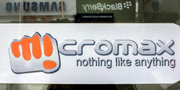 A MicroMax Informatics Ltd. logo is displayed on a store window reflecting Samsung Electronics Co. and...