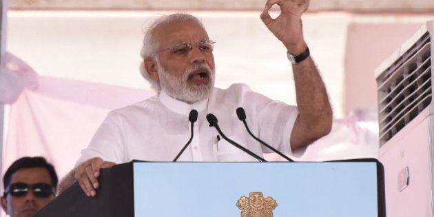 NEW DELHI, INDIA - MARCH 19: Prime Minister Narendra Modi speaks during the three-day Krishi Unnati Mela providing information on new farm schemes and technologies that will help farmers double their incomes within the next few years, on March 19, 2016 in New Delhi, India. Modi described the Krishi Unnati Mela as a platform that could rewrite India's destiny. (Photo by Virendra Singh Gosain/Hindustan Times via Getty Images)