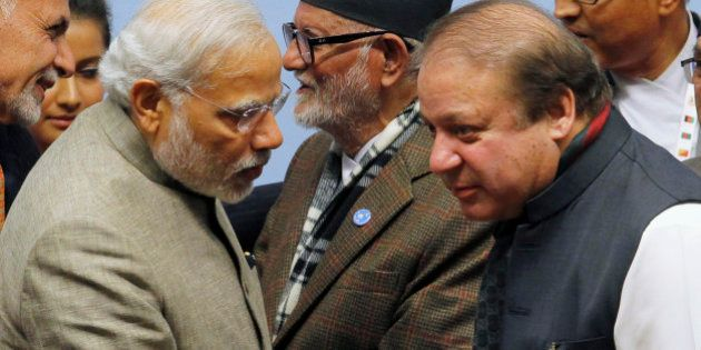 India's Prime Minister Narendra Modi (L) talks to his Pakistani counterpart Nawaz Sharif (R) during the...