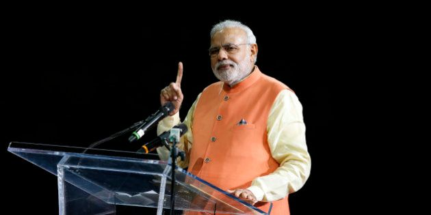 Prime Minister Narendra Modi of India gives a speech during a reception by the Indian community in honor...