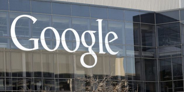 File-This Jan. 3, 2013 file photo shows a Google sign at the company's headquarters in Mountain View,...