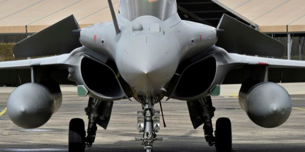 Rafale fighter aircraft stand on the tarmac of the air base of Mont-de-Marsan, southwestern France on...