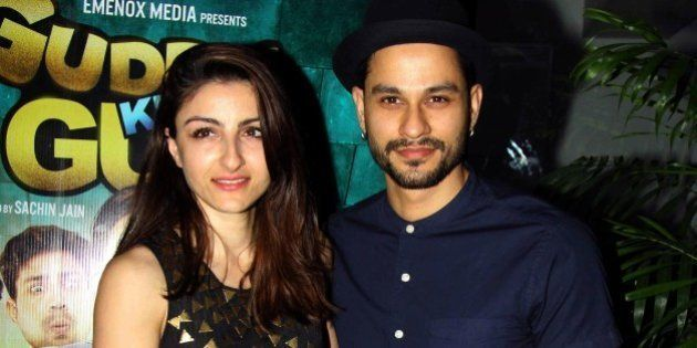 Indian Bollywood actress Soha Ali Khan (L) poses with her husband actor Kunal Khemu as they attend a...