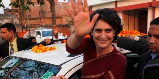 India's ruling Congress party president Sonia Gandhi's popular daughter Priyanka Gandhi Vadra waves during...