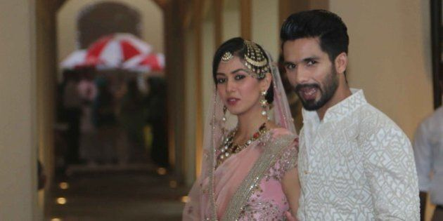 GURGAON, INDIA - JULY 7: Bollywood actor Shahid Kapoor with his wife Mira Rajput poses for his first...