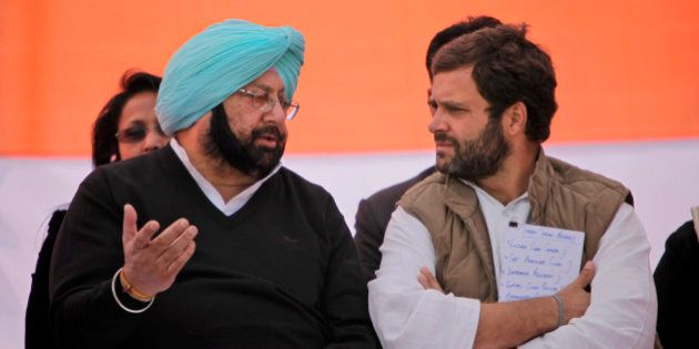 India's ruling Congress party leader Rahul Gandhi, right, speaks with former chief minister of Punjab...