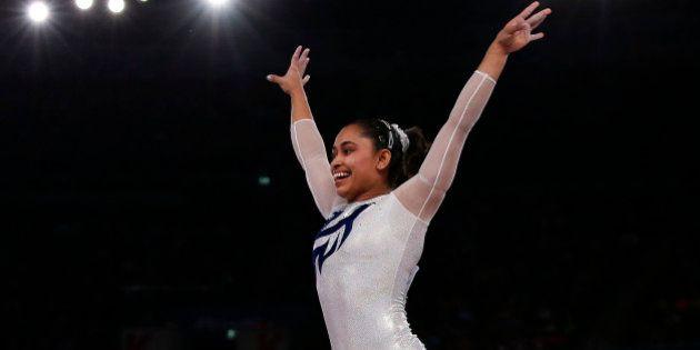India's Dipa Karmakar reacts after a successful vault during the women's gymnastics vault apparatus final...