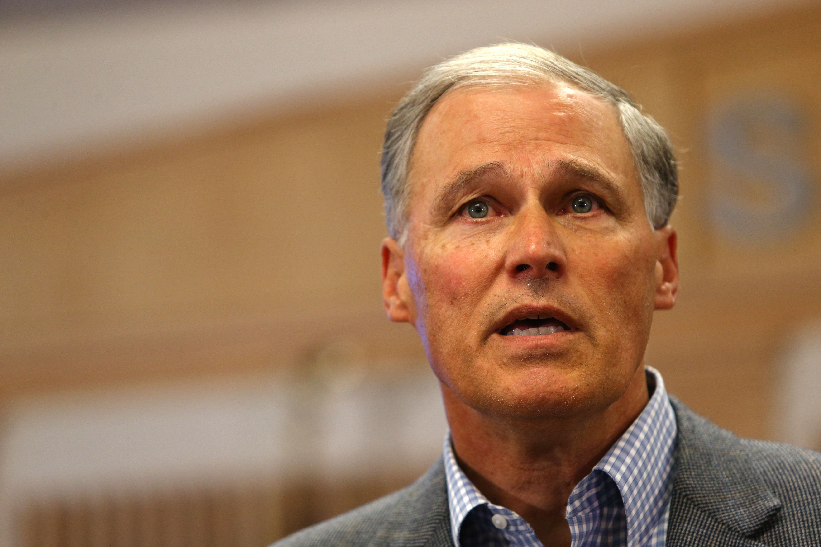 BURLINGTON, WA - SEPTEMBER 24: Governor Jay Inslee (L) of Washington State speaks at a press conference on September 24, 2016 in Burlington, Washington. Officials announced the gunman was caught in Oak Harbor, Washington and is in custody. Last night five people were shot and killed in the Cascade Mall. (Photo by Karen Ducey/Getty Images)
