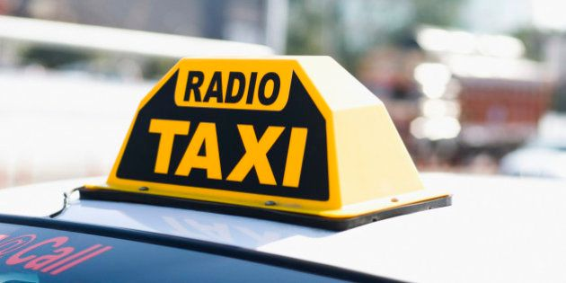 Close-up of a Radio Taxi sign on a taxi roof, Delhi,