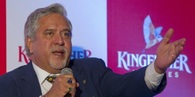 Kingfisher Airlines Chairman Vijay Mallya speaks to the media during a news conference in Mumbai November...