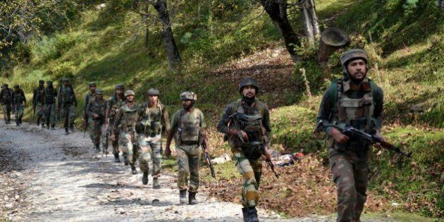 Indian army soldiers take positions at Hafruda forest in Kashmir's Kupwara district, around 140 kilometres...