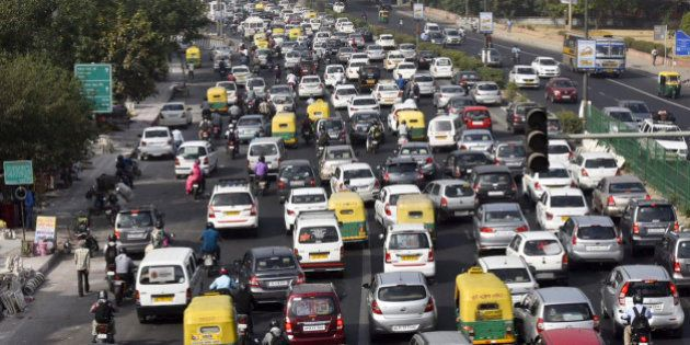 NEW DELHI, INDIA - APRIL 18: Slow traffic at NH-24 during the Odd-Even Plan on April 18, 2016 in New...
