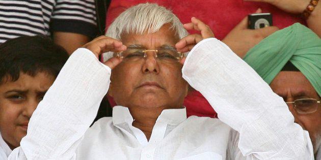 India's Rashtriya Janata Dal (RJD) chief Lalu Prasad Yadav attends an election campaign rally in the...