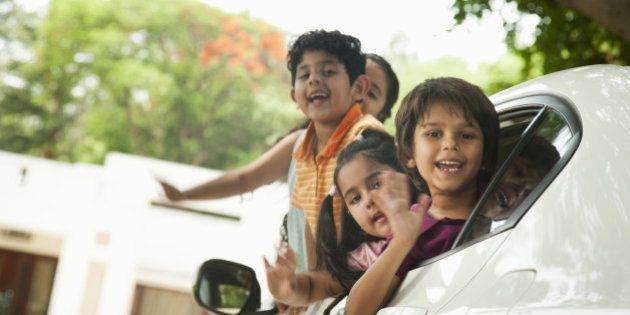 Kids (4-7) leaning out of car