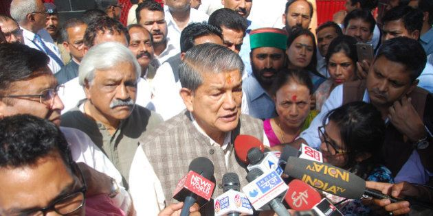 DEHRADUN, INDIA - MARCH 28: Former CM Harish Rawat with his MLAs and supporters coming out of the Governor's...