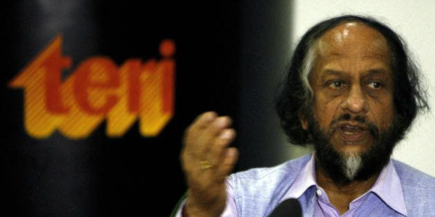 Director-General, TERI and Chairman, Intergovernmental Panel on Climate Change R.K. Pachauri gestures as he answers a question during a press conference in New Delhi on July 8, 2008, on Opportunities and Implications Related to India's National Action Plan on Climate Change (NAPCC). The NAPCC was unveiled on June 30, demonstrating India's commitment to meeting the challenges of climate change,  NAPCC signals India's intent to move towards greater use of renewable energy resources and more efficient managemnet of critical natural resources such as water.  AFP PHOTO/ Manpreet ROMANA (Photo credit should read MANPREET ROMANA/AFP/Getty Images)