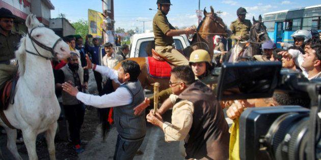 DEHRADUN, INDIA - MARCH 14: MLA Ganesh Joshi beating a horse during a BJP rally at Vidhansabha, on March...
