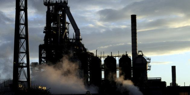 One of the blast furnaces of the Tata Steel plant is seen at sunset in Port Talbot, South Wales, May...