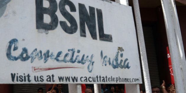 Employees of the state-run Bharat Sanchar Nigam Limited (BSNL) shout anti-government slogans at the BSNL...
