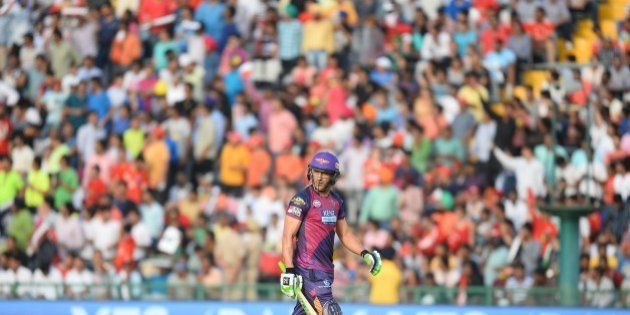 Rising Pune Supergiants Faf Du Plesis walks off the pitch after being dismissed during the 2016 Indian...