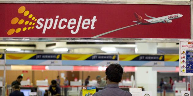 A traveler waits in front of a SpiceJet Ltd. ticket counter at Netaji Subhash Chandra Bose Domestic Airport...