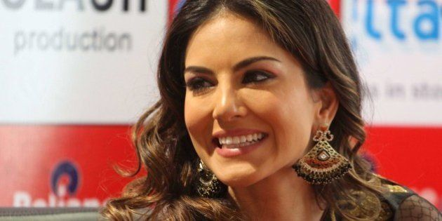 Film star Sunny Leone smiles during a press conference supporting her upcoming movie 'Shootout At Wadala'...