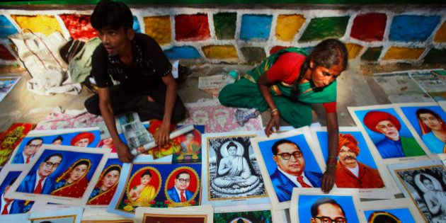 Indian street vendors display portraits of Bhim Rao Ambedkar, wearing the glasses, on his death anniversary...