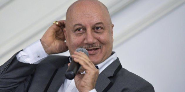 From left: Indian actors Anupam Kher takes part in a discussion on the links between Indian theater and...