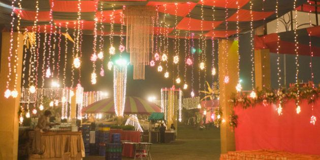 Decorative lights of a wedding tent lit up at