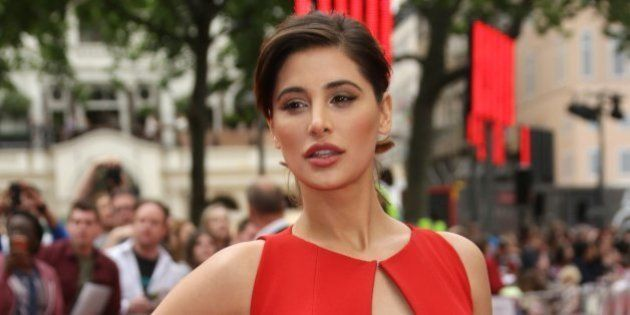 Nargis Fakhri poses for photographers upon arrival for the European premiere of Spy at the Odeon West...