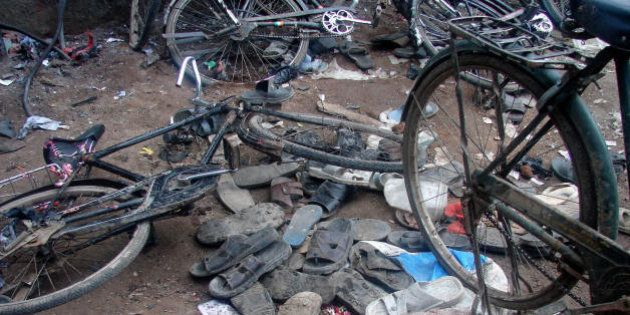 Malegaon, INDIA: Piles of discarded shoes and fallen bicycles litter a street outside a mosque in Malegaon,some...