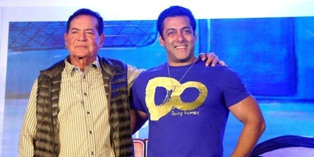 Indian Bollywood actor Salman Khan (R) and screenwriter Salim Khan pose for a photograph during a promotional...