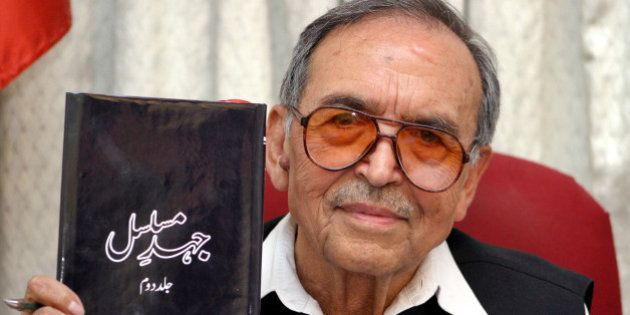 Amanullah Khan, chief of the Jammu and Kashmir Liberation Front (JKLF), holds his