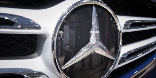The Mercedes-Benz badge is displayed on a GLC300 4Matic sport utility vehicle (SUV) at the Beijing International...
