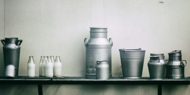 Old milk jugs, cans and bottles at dairy
