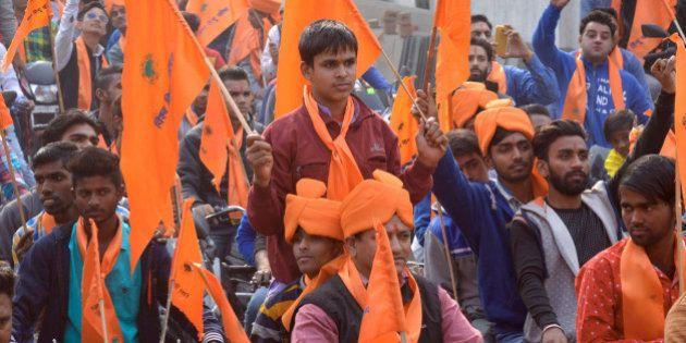Indian activists of Hindu Bajrang Dal, along with Vishva Hindu Parishad (VHP) organizations, raise religious...