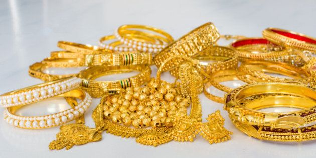 Gold jewellery or jewelry including pure gold bangles and gold with pearl bangles, rings, ear rings,...