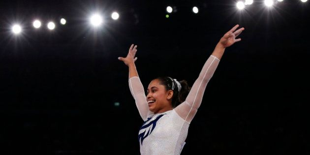 India's Dipa Karmakar reacts after a successful vault during the women's gymnastics vault apparatus final...