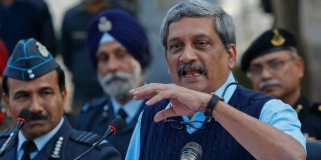 Indian Defense Minister Manohar Parrikar addresses the media at the Indian air force base in Pathankot,...