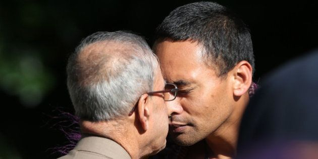 Indian President Pranab Mukherjee (C) is greeted with a Hongi, a traditional Maori greeting, during a...