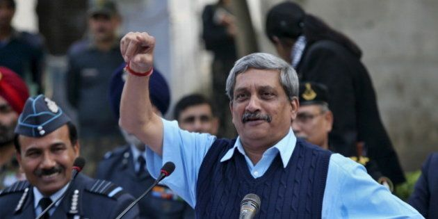 India's Defence Minister Manohar Parrikar gestures during a news conference as India's Air Chief Marshal...